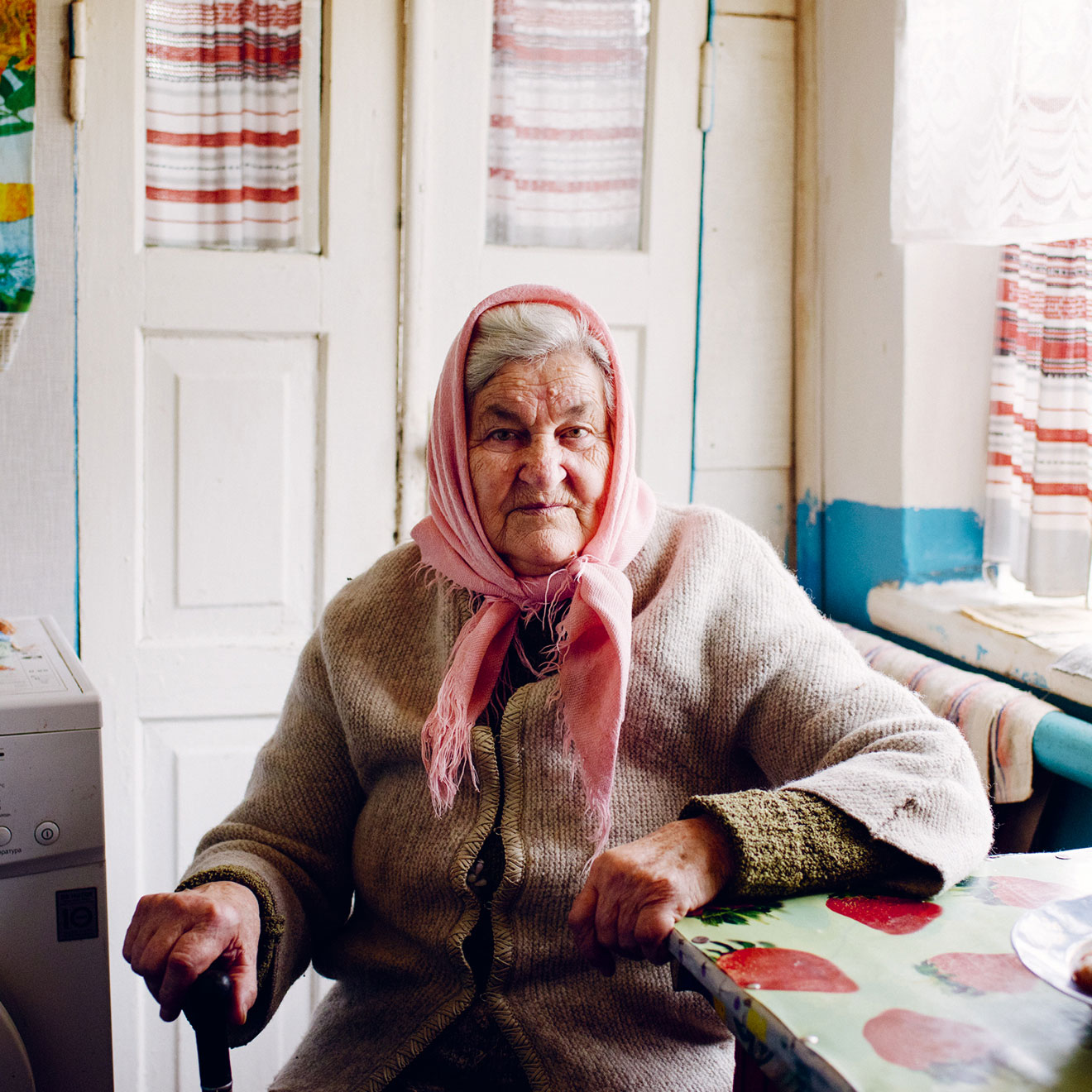 A photograph by Chris Nunn of an elderly woman in Ukraine. From Weapons of Reason: The New Old